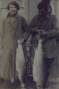 Black-and-white photo of Stephen and Nance O'Mara, holding fish