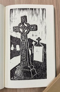 opened book with text and woodcut of a Celtic cross