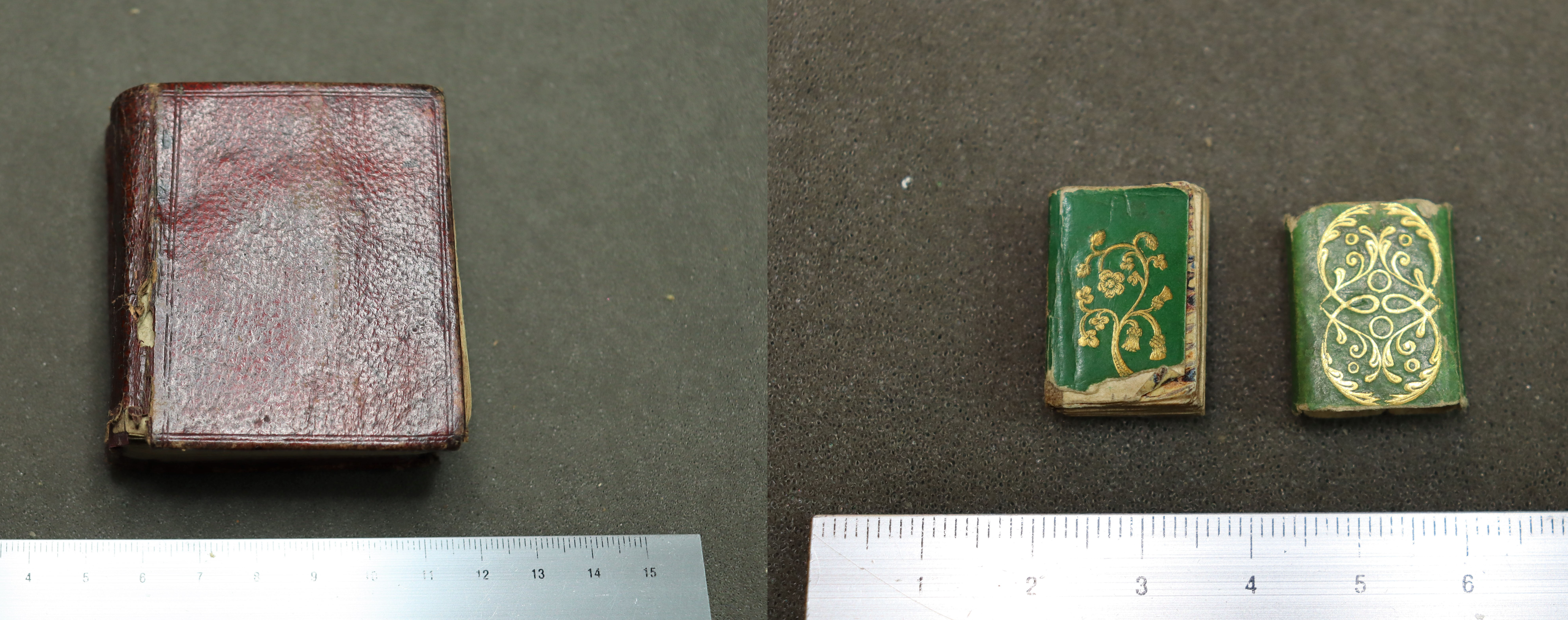 a composite image of two miniature books on grey background, one book is red the other is green with gold decorations
