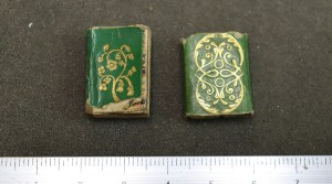 Green miniature book and slipcase with cold decorations