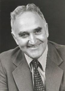 black-and-white portrait of smiling Gerard Gallivan in formal attire
