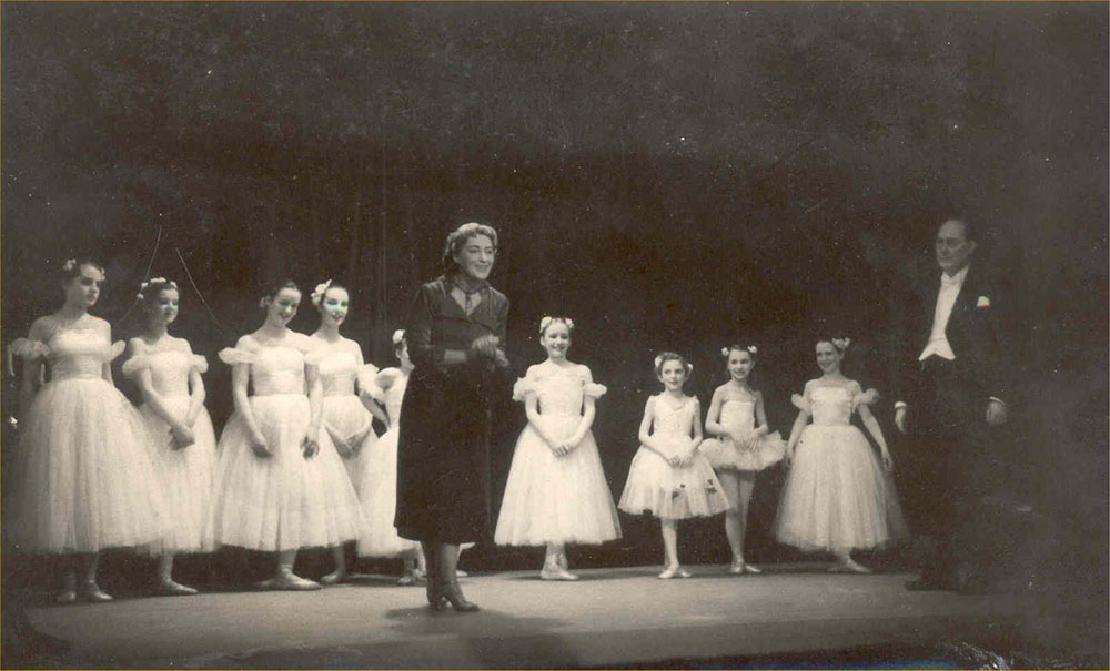 black-and-white picture of pupils of the Irish National Ballet School in white dresses on a stage, Valentian Dutko in the front