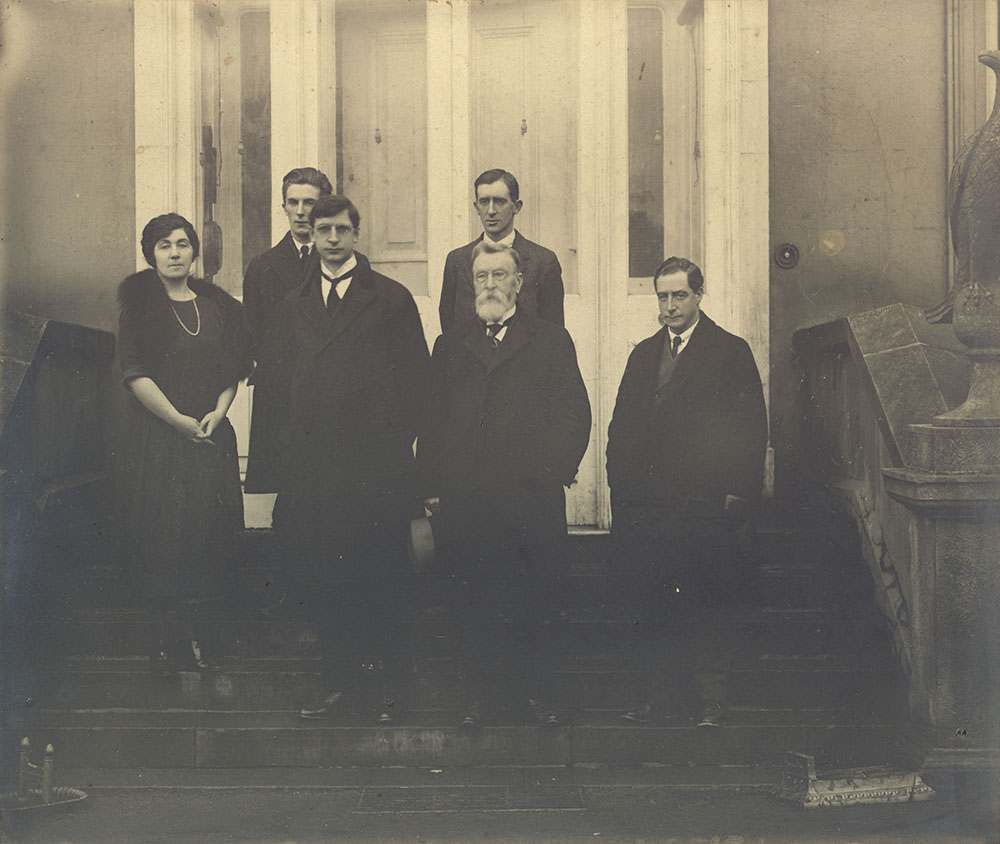 black-and-white group picture of a woman and five men on stairs, de Valera in the front row
