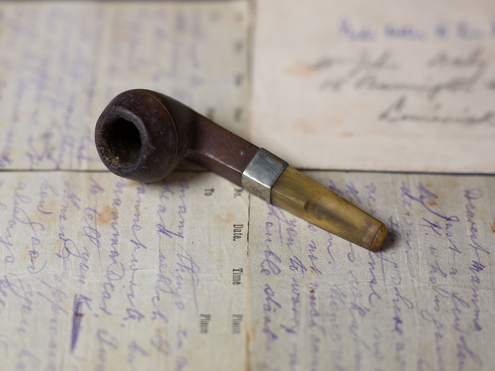 Edward (Ned) Daly's pipe lying on a handwritten letter to his mother