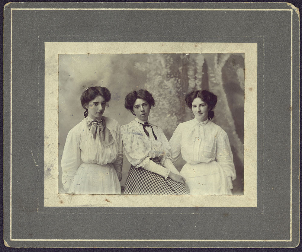 black-and-white portrait of Nora, Agnes and Annie Daly in formal attire