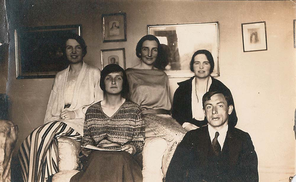 black-and-white image of Anne, Kate, Clare and May O'Brien with Gustaaf Renier, all seated