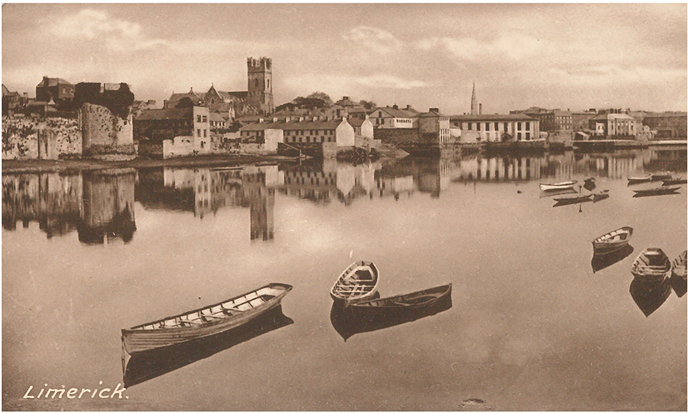 Black and white postcard displaying Limerick city from across the Shannon