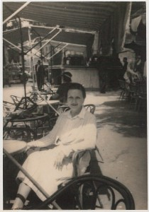 Photograph of Kate O'Brien sitting in a café facing the camera.